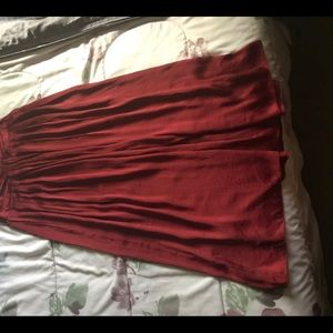 Long red silk pleated skirt